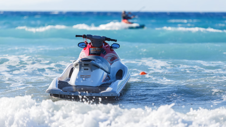 Blue sea and a jet ski floating on the ,