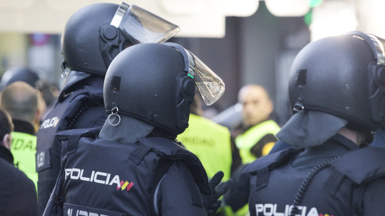 Three riot police